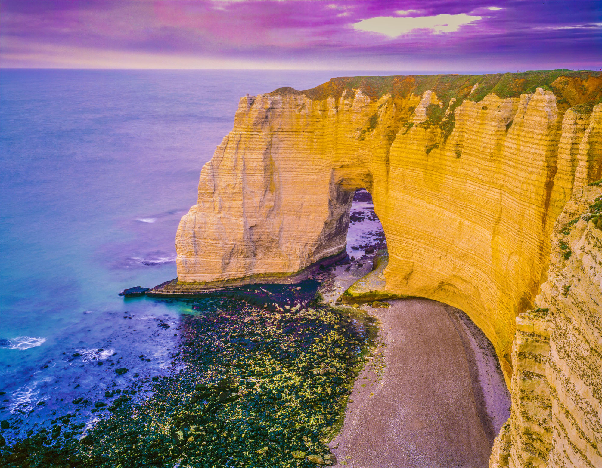 Sea arch, White Cliffs of Etretat, France photographed by Tom Till