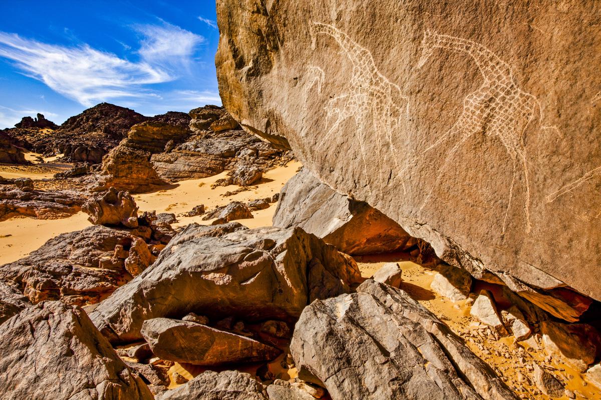 Giraffe petroglyphs, Jebel Acacus, LIbya, Africa, Sahara photographed by Tom Till