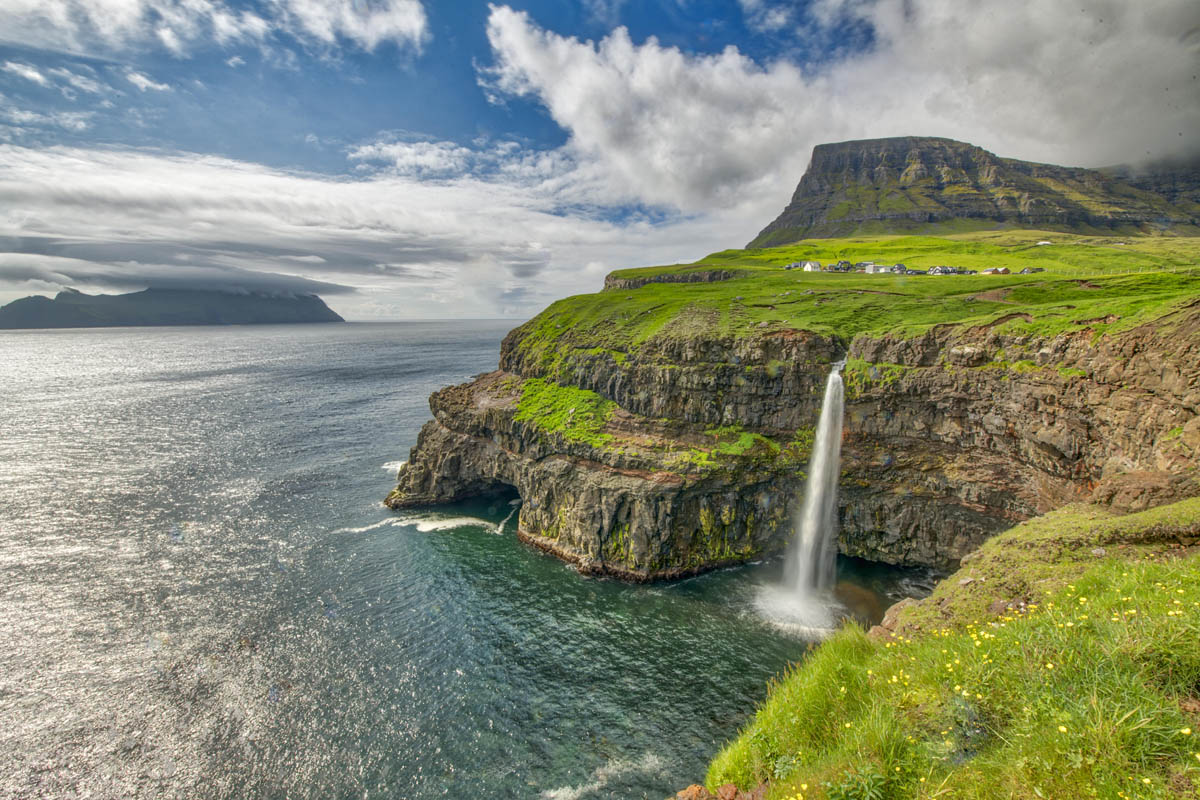 Mulafossur Waterfall, Vagar Island, Faroe Islands photographed by Tom Till